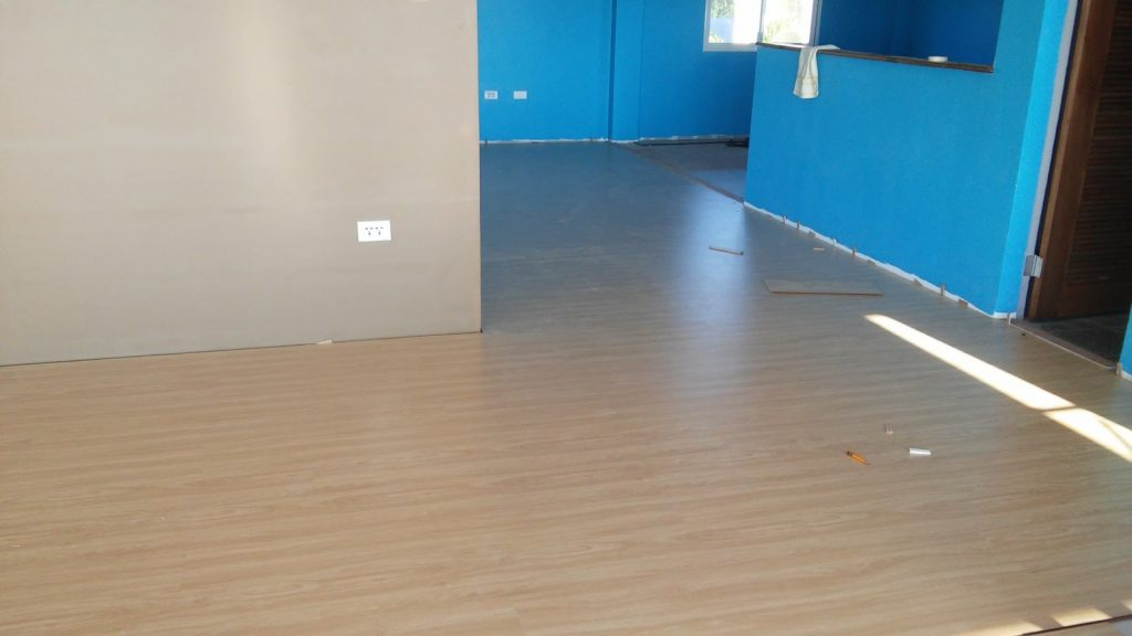 LAMINATE WOOD FLOORING AND CABINET DOORS